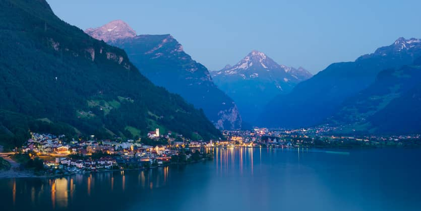 Night landscape. Chalets and traditional houses in Switzerland. Mountain village in Central Europe. Canton Uri. Altdorf.